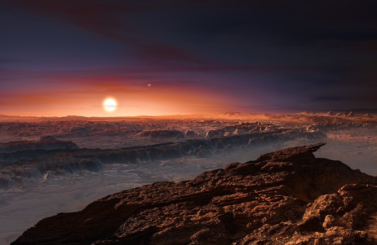 This artist's impression shows a view of the surface of the planet Proxima b orbiting the red dwarf star Proxima Centauri, the closest star to the Solar System. The double star Alpha Centauri AB also appears in the image to the upper-right of Proxima itself. Proxima b is a little more massive than the Earth and orbits in the habitable zone around Proxima Centauri, where the temperature is suitable for liquid water to exist on its surface. Crédito: ESO/M. Kornmesser